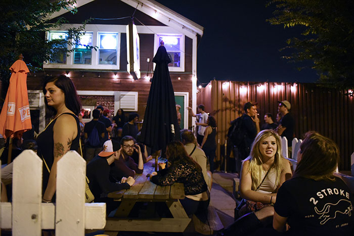 Patrons enjoy the outside seating area on a Saturday night at the Hideout in Chicago, July 15, 2017 ©2017 Alex Garcia